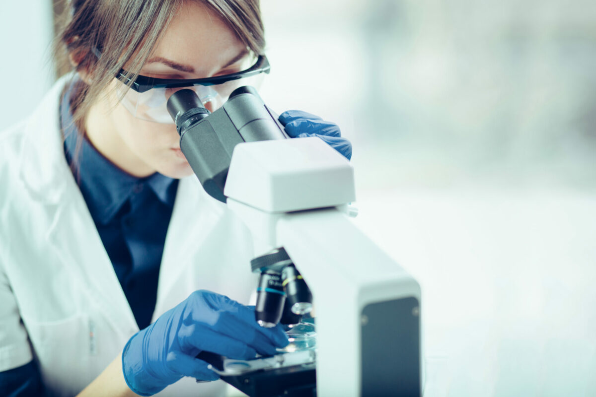 Picture of a scientist working with samples using a microscope